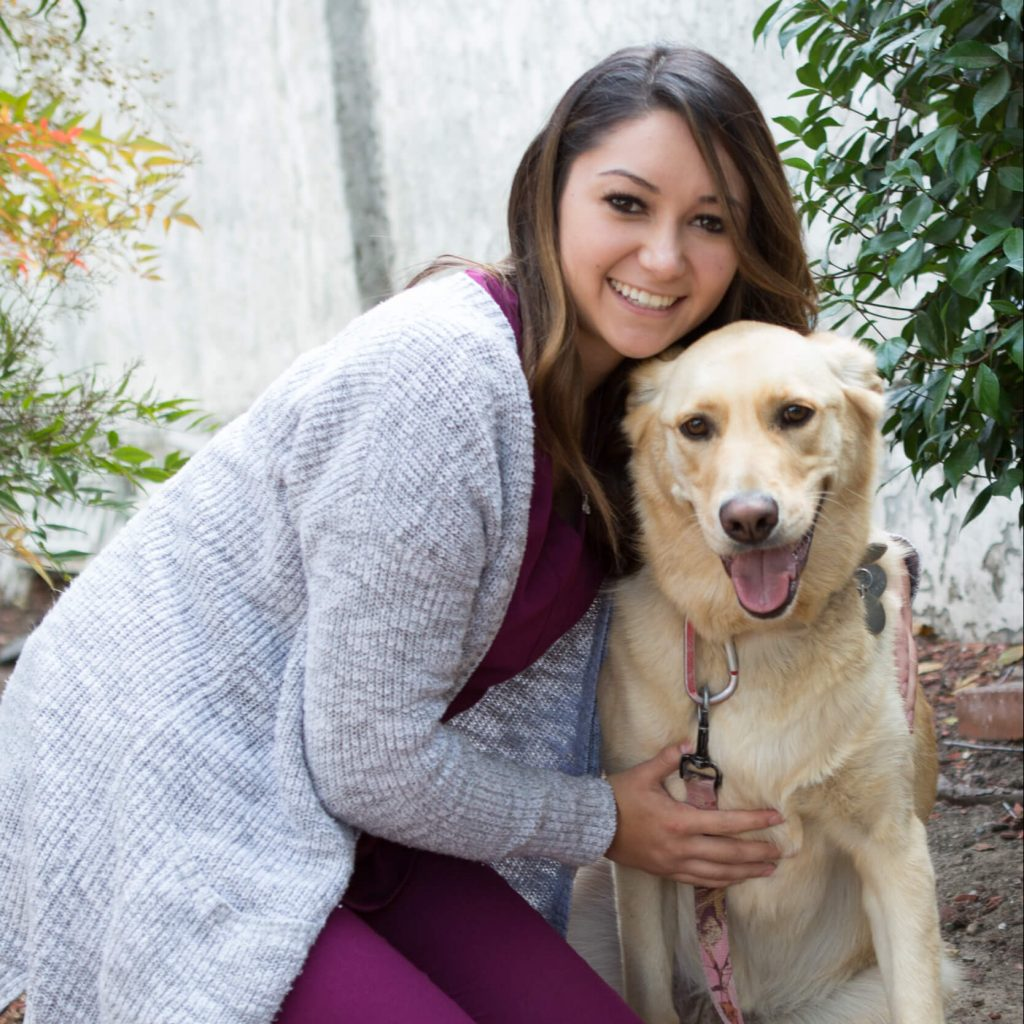 Team member Tifany with a yellow Labrador